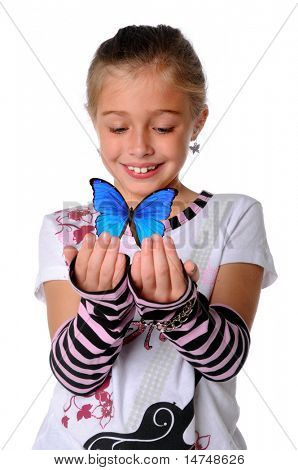 Young Girl holding butterfly with her hands