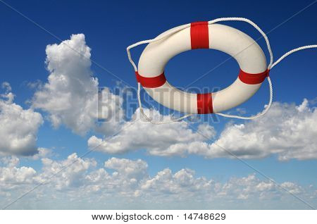 Life preserver over a sky with bright clouds