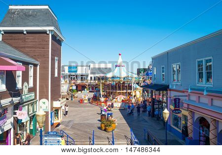 San Francisco USA - September 21 2015: Tourists between the attractions shops and restaurants in the Pier 39.