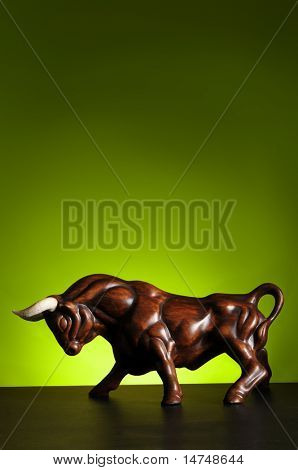 Bull figure over a green background with spot light