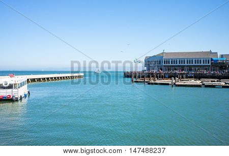 San Francisco USA - September 23 2015: A crowd of tourists on the Pier 39 near the harbor mouth