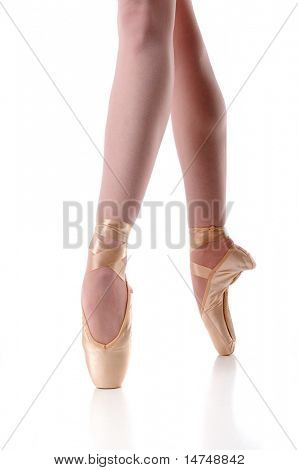 Ballerina's feet in pointe over a white background