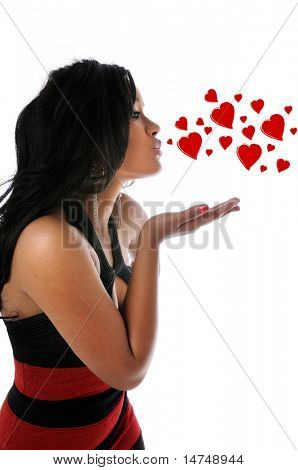 Young beautiful woman blowing kisses isolated over a white background