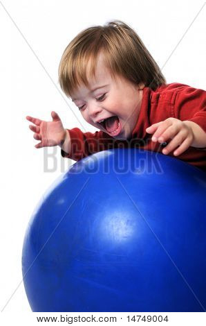 Child with Down Syndrome smiling and playing with ball isolated over a white background.