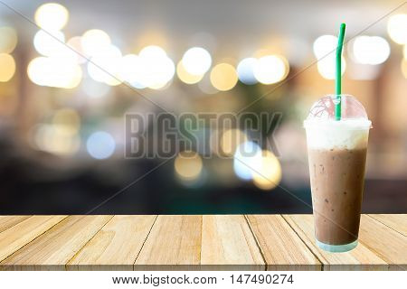 Ice coffee .Coffee Frappuccino and blurred cafe with bokeh light background.