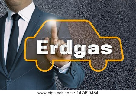 Erdgas (in German Cng) Touchscreen Is Operated By Businessman Concept