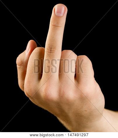 Hand showing fuck off with the middle finger. Isolated on a black background