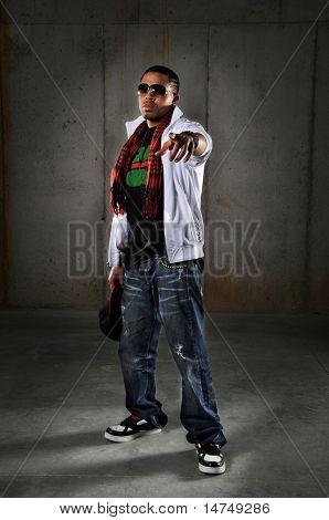 Hip hop African American man pointing over an urban background