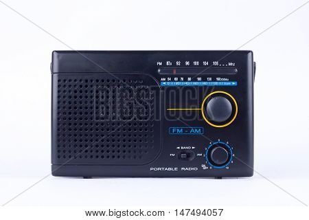 AM, FM portable radio transistor receiver of old black vintage retro style   on white background  isolated