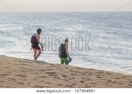 JERICOACOARA, BRAZIL, DECEMBER - 2015 - Couple at beach in the famous dune of Jericoacoara