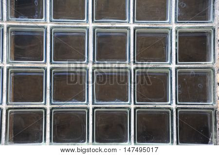 Background image shows large window composed of individual squares of thick glass. Building is in Stoughton Wisconsin.