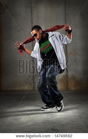 African American hip hop dancer performing over grunge background