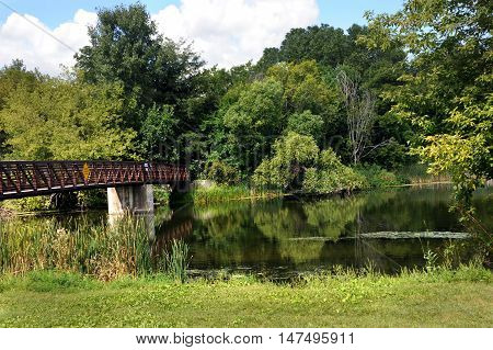 Bridge spans the Yahara River at Cooper's Causeway. Bridge marks the beginning of the Yahara River Trail in Stoughton Wisconsin.