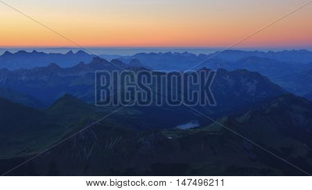 Mountains of the Swiss Alps at sunset. View from Sex Rouge Glacier de Diablerets. Summer scene.