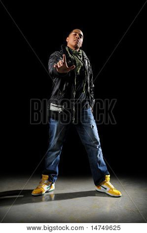Young African American hip hop dancer performing