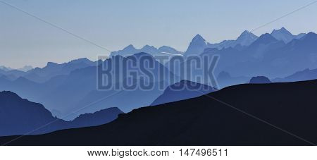 Morning scene in the Swiss Alps. High mountains in the Bernese Oberland. View from Sex Rouge Glacier de Diablerets.