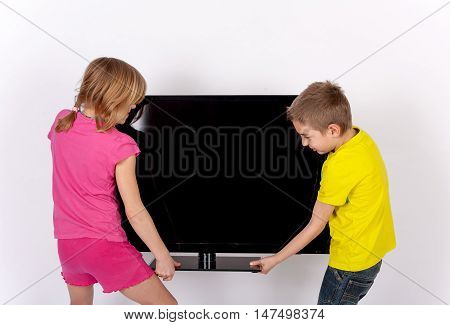 The Siblings fighting over a big TV