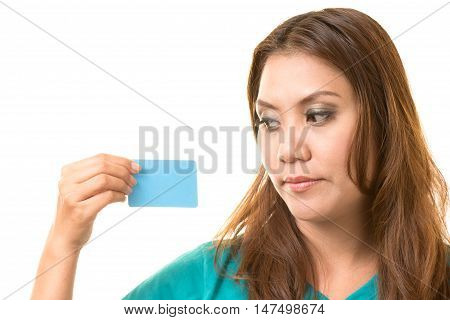 asian woman holding card on white background