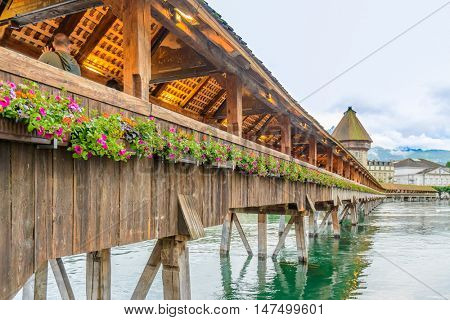 Famous Chapel Bridge in the historic city center of Lucerne with, the city's symbol and one of Switzerland's main tourist attractions and views, Canton of Lucerne, Switzerland