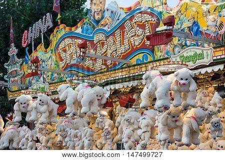 10th September 2016, Bad Dürkheim, Wurstmarkt 2016 (wine festival), Germany: Large showcase (carnival toy stand) with plenty of white teddy bears
