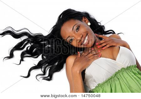 Young African American woman with long hair laying on white floor