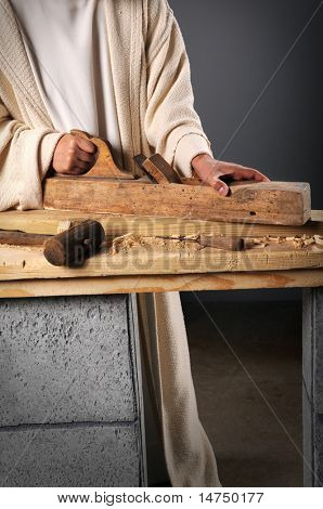 Jesus the carpenter working with a wood plane on a bench