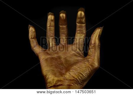 terrible human hand on a black background The golden color of human skin zombie hand