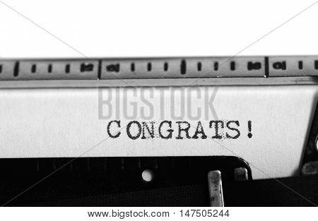 Typewriting on an old typewriter. Typing text: congrats !