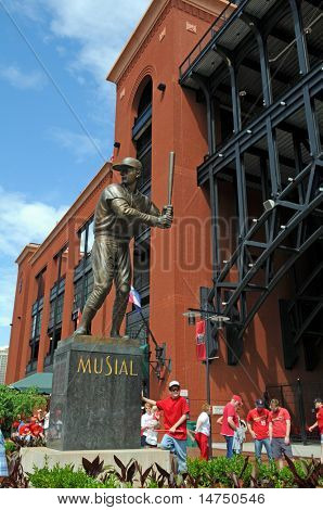 "ST LOUIS â?? MAY 23: Baseball fans stand near the statue of Stan ""The Man"" Musial outside of Busch Stadium on May 23, 2009 in St Louis, Missouri. Busch Stadium is the home of the Saint Louis Cardinals."