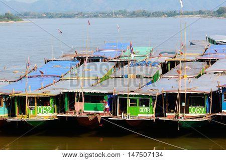 CHIANGRAIT HAILAND - MAY 17 : Laos and Burmese transportation boat park at Port of Chiang saenwaiting for export goods at Chiang saen Chiangrai Thailand on May 17 2016