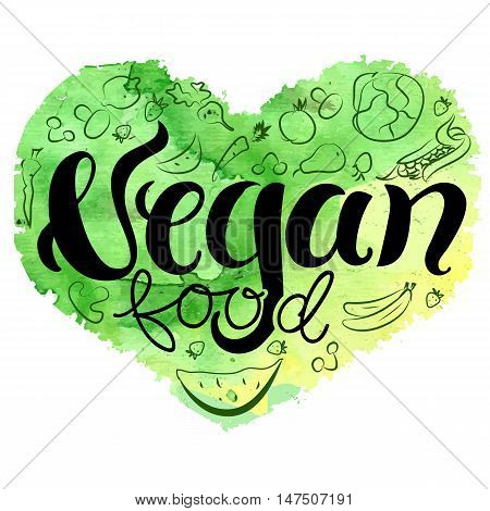 Vegan heart, vector drawing: the word vegan food, written in brushpen calligraphy, on ahand drawn green heart with sketches