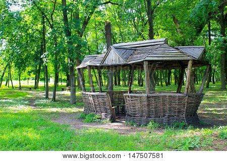 Old wooden gazebo in the green park