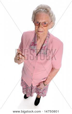 Portrait of serious senior woman pointing finger isolated over white