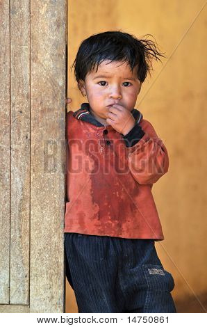 CAJABAMBA PERU - SEPTEMBER 8: Portrait of poor young boy, Cajabamba, Peru on September 8, 2009