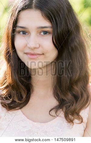 Portrait a of modest teen girl on nature summer