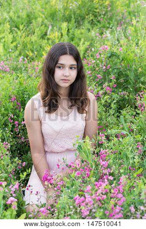 Portrait a of sad teen girl on nature summer