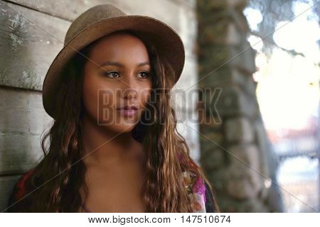 Pretty girl with long hair lost in deep thought