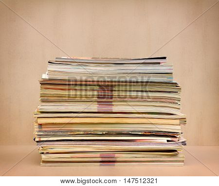 a large stack of magazines close-up front view. toned photo
