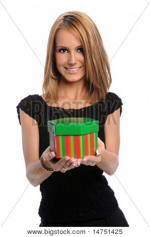 Young woman offering gift isolated over white background