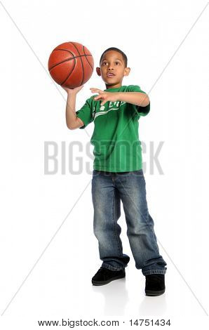 Young African American boy playing basketball isolated over white background
