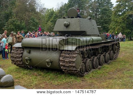 Gatchina, Russia - September 11, 2016: The historical reconstruction of World War II. Soviet heavy tank KV-1. Back view. Spectators visiting the tank.