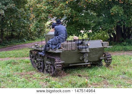 Gatchina, Russia - September 11, 2016: The historical reconstruction of World War II. Lightweight floating tank T-37A. Tank goes to explore, on the armor is a military korresondent.