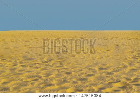 Sand And Blue Sky Background