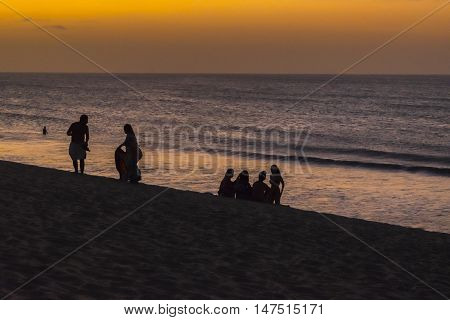 JERICOACOARA, BRAZIL, DECEMBER - 2015 - People at beach in the famous dune of Jericoacoara at sunset time