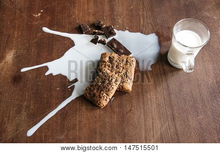 Chocolate, bread and spilled milk on the table.Top view. Eco life concept.