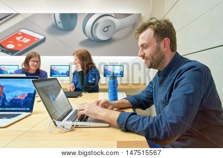 CHICAGO, IL - MARCH 24, 2016: indoor portrait of a man at Apple store. Apple Store is a chain of retail stores owned and operated by Apple Inc., dealing with computers and consumer electronics.