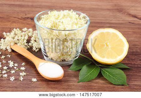Elderberry Flowers And Ingredients For Preparing Juice On Rustic Board