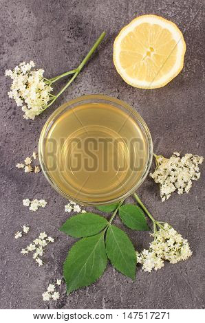 Fresh Healthy Juice, Elderberry Flowers And Lemon On Structure Of Concrete