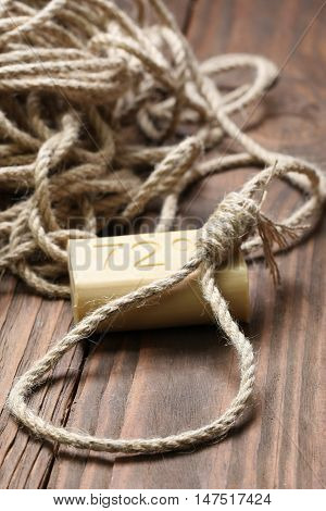 a loop of rope and soap close-up on a background of wooden planks