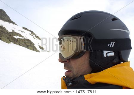 Skier In A Chairlift Going Up Of A Mountain